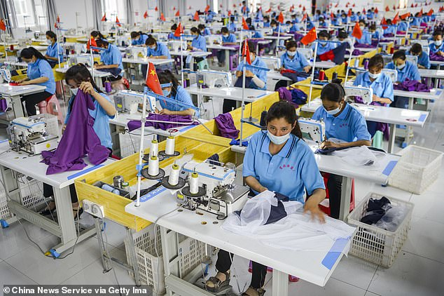 China was forcing Uyghur workers to mass-produce face masks as part of the country's `` re-education '' program for Muslims during the coronavirus pandemic, according to a report in August. The photo taken on June 18 shows workers at a garment factory in Aketao County, Xinjiang.