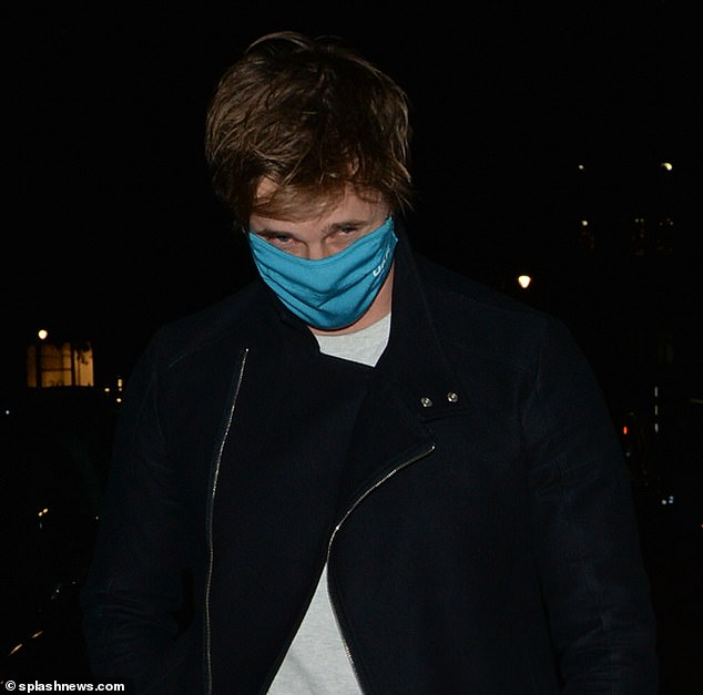 Play it safe: Maura's buddy put on a blue face mask for the walk
