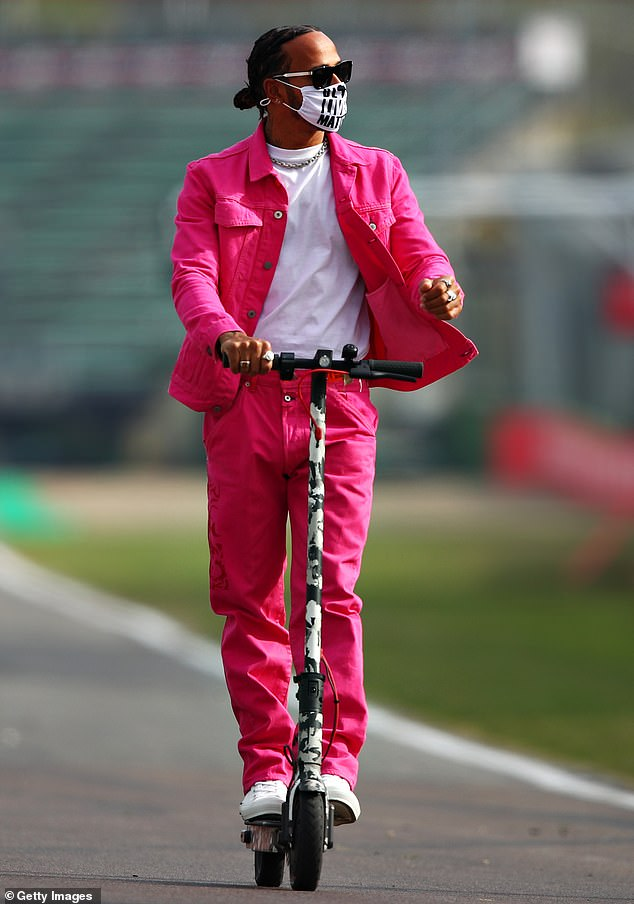 Hard to miss: He's used to crossing the finish line in first place, but Lewis Hamilton received an unexpected red flag on Friday thanks to his garish new outfit