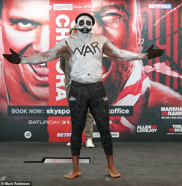 Derek Chisora has bizarrely shown up for his weigh-in ahead of his clash Oleksandr Usyk in white paint