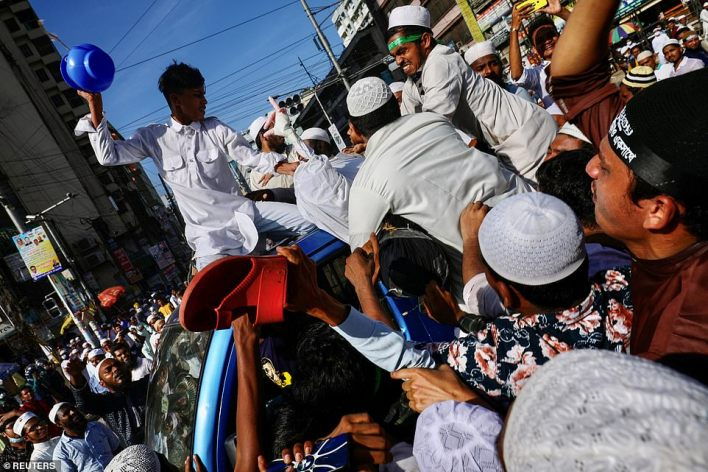 BANGLADESH: Protesters attack a Macron effigy as they take part in a protest in Dhaka a day after a terror attack in Nice