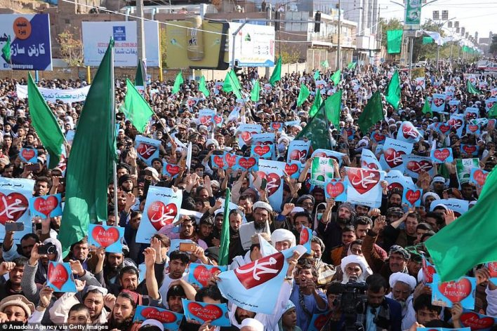 People gather to protest against comments by French President Emmanuel Macron defending cartoons of the Prophet Mohammed in Herat, Afghanistan