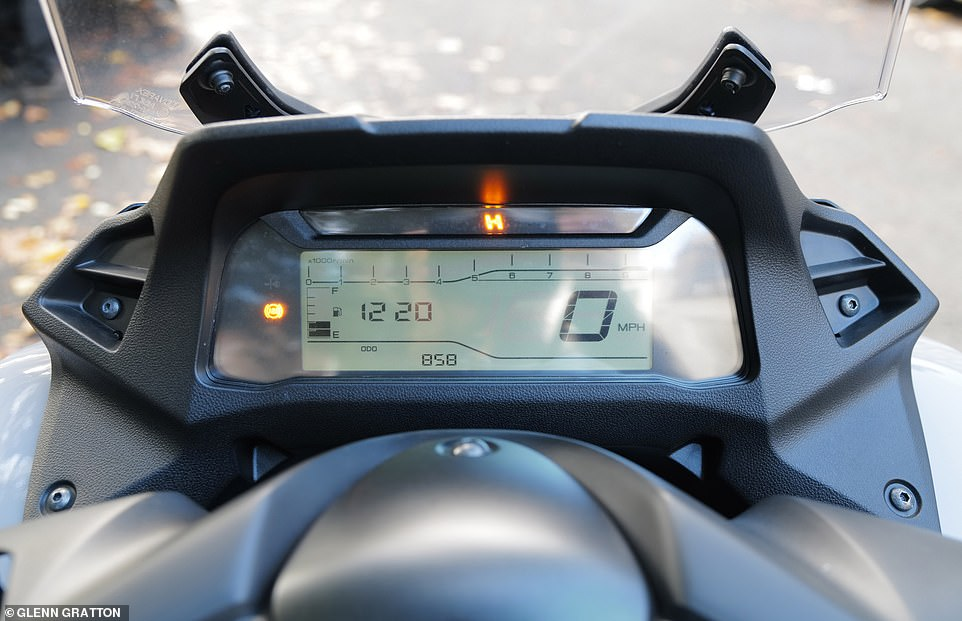 The orange 'H' indicates that the front forks are locked in place, so the bike won't be able to topple over to one side