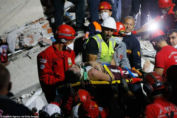 28-year-old Malik Tahirler is being rescued from wreckage by the search and rescue teams in Bornova district