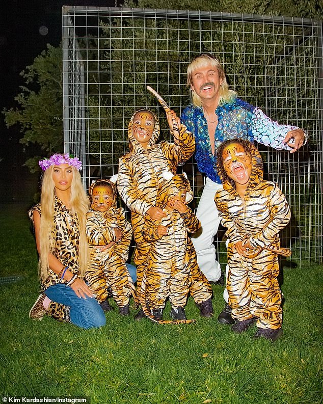 Family fun:Kim Kardashian dressed as Carole Baskin from Tiger King. And her pal Jonathan Cheban was Joe Exotic: 'I don¿t think anything will beat Sonny and Cher BUT this comes Close!! Joe Exotic, Carol Baskin and MY tigers'