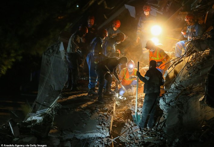 Rescue teams going through the debris of a collapsed building in Bayrakli district