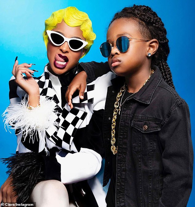 So Cardi!Ciara wore a yellow wig to dress up as Cardi B while her son Future Jr posed as Offset with a jean jacket and a thick gold chain