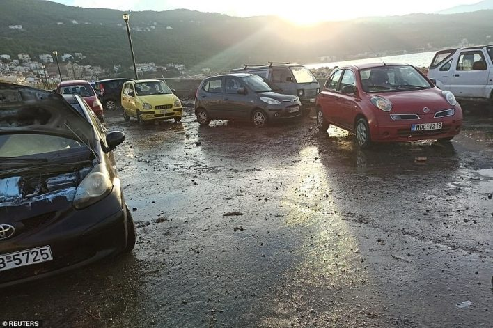 Cars are damaged and covered in muck at the port of Vathy in Greece where the mini-tsunami reached the Aegean island