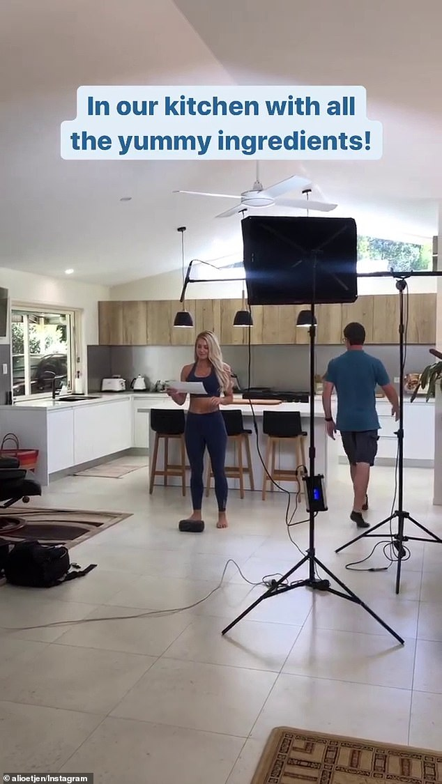 'In our kitchen with all the yummy ingredients': Posting to Instagram, the 34-year-old shared behind-the-scenes clips as she filmed promotional videos for the launch