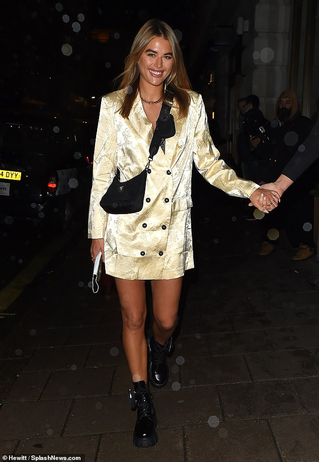 Nice: The former Love Island star, 29, looked incredibly stylish in a satin yellow suit-style mini dress when she left the glamorous restaurant