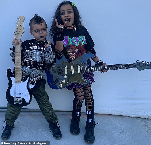 Musical: Kourtney's five-year-old son Reign could be seen in a 'Halloween Rock And Roll' double costume with his seven-year-old cousin North West