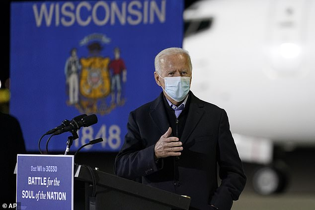 Moore said that the unscientific way to get Biden's true lead was to take what his number was and to cut it in half. Biden is show in Wisconsin on Friday