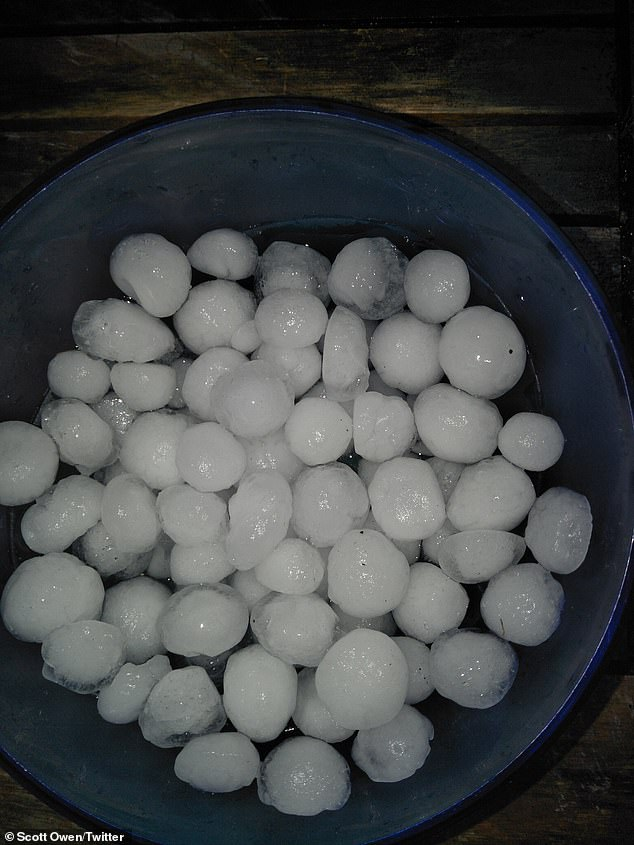 Severe thunderstorms that formed along the Great Dividing Range are pushing towards the coast from the NSW border to areas north of the Sunshine Coast (pictured, hail in Brisbane)