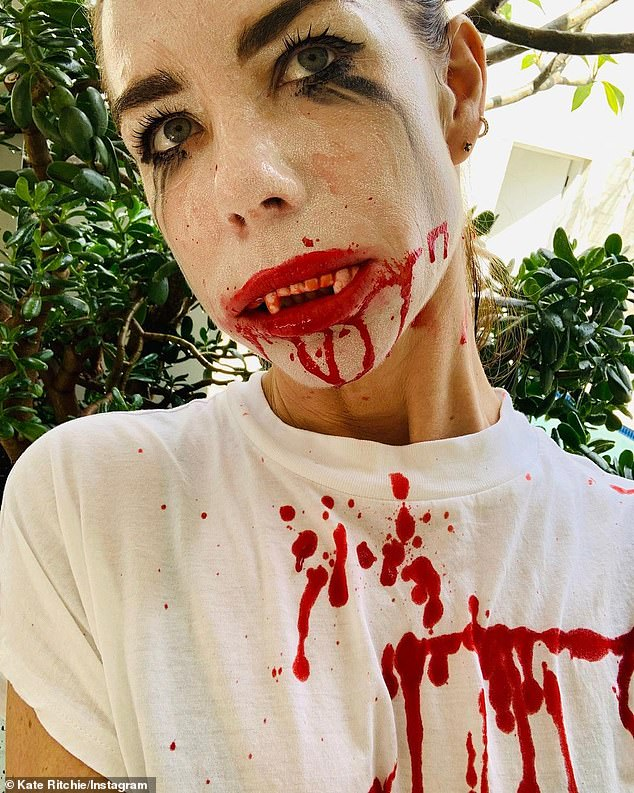 Frightening! Kate Richie went all out for Halloween on Saturday. She shared a photo of herself on Instagram in an elaborate vampire costume,painting her face white, mascara running down her face, red lips and vampire teeth, as well as blood dripping down her chin and T-shirt