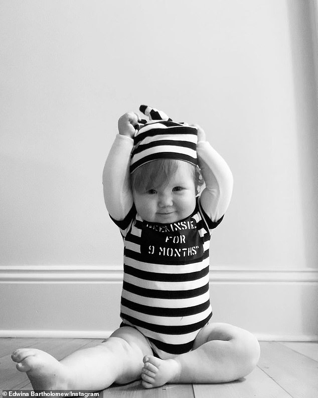 Cute: Sunrise's Edwina Bartholomew posted a photo of her adorable daughter Molly in a prisoner-themed onesie that read: 'Been inside for nine months.'