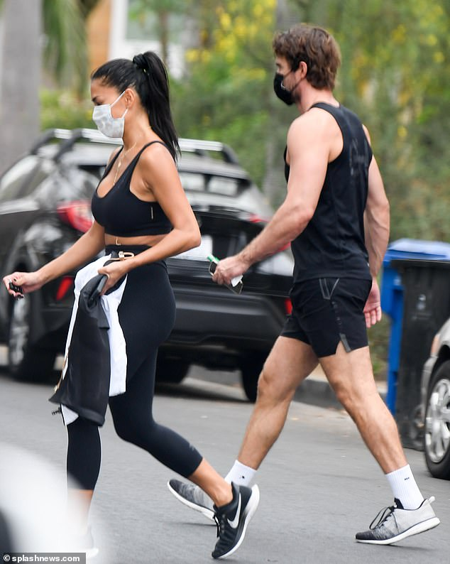 Working on their fitness: Nicole Scherzinger was spotted heading to the gym alongside her beau Thom Evans in Los Angeles on Friday