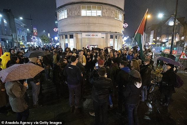 """Over 50 protesters gatheredat Camden Town tube station on Friday night for the anti-lockdown rally called """"Cancel The Curfew"""""""