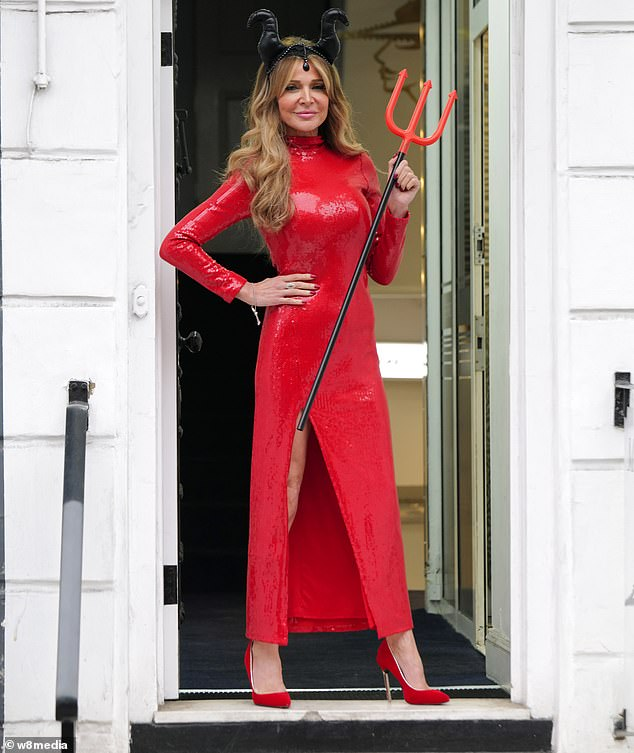 Centre of attention: The TV personality, 52, displayed her slender physique in her showstopper outfit as she exited George Vallossia salon in Knightsbridge