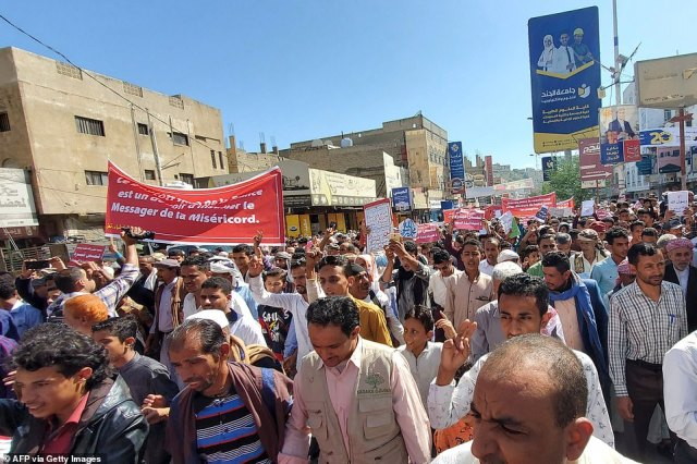 Demonstrators chant slogans as they march with banners during a rally protesting against the comments of French President Emmanuel Macron over Prophet Mohammed cartoons in Yemen's third-city of Taez today