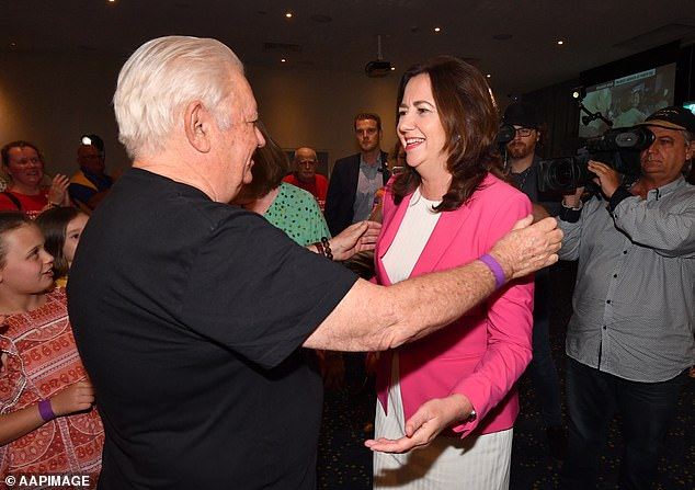 Premier Annastacia Palaszczuk's father (pictured together on Saturday) said his daughter won victory in the Queensland election because she kept people safe during COVID-19
