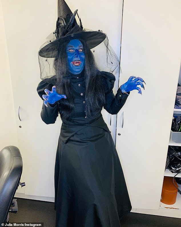 Yikes! Comedian Julia Morris, 52, went all out for her witch costume by painting herself blue