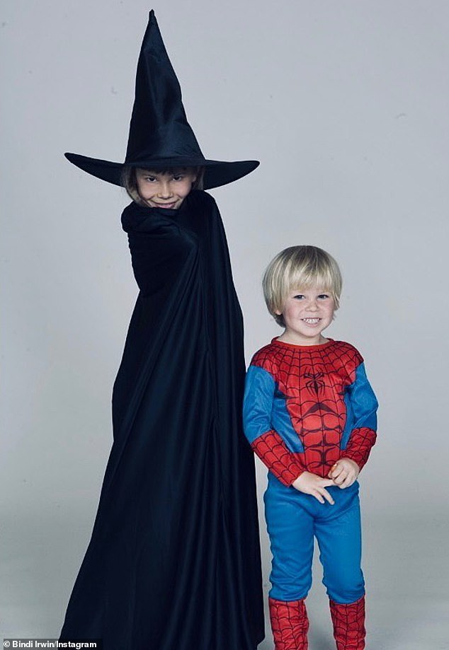 Memories: Bindi also shared a throwback photo of herself and younger brother Robert dressed up for Halloween in 2007. She dressed up as a witch, with a black cape and a pointy hat, while he wore a Spider Man outfit