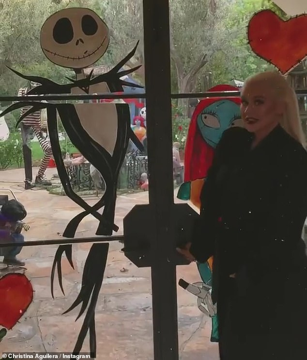 In the tour: Christina showed off her lavish property as it was done up in Halloween decorations inspired by the Tim Burton Halloween classic The Nightmare Before Christmas