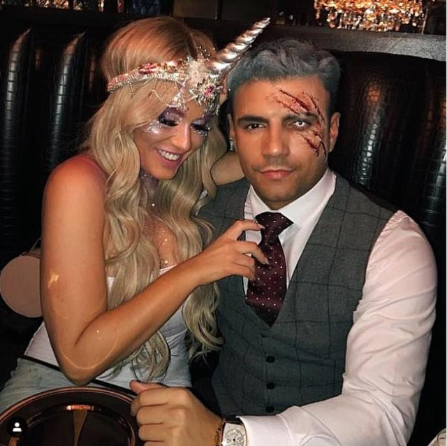 Spooky: Vicky Pattison was seen sporting a unicorn headband while Ercan donned a special effects make-up look in a throwback Halloween snap posted on Saturday