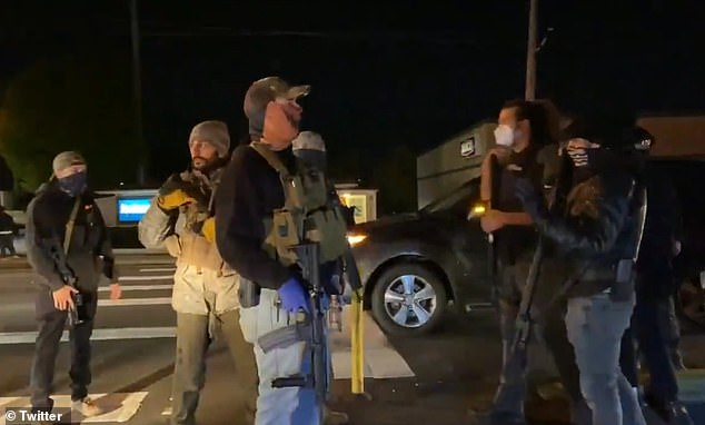 The gun-toting vigilantes tell the BLM protesters to get out of the streets and say 'this isn't Portland'