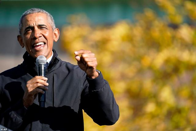 Mockery: Barack Obama went after Donald Trump's performance in office saying: 'COVID COVID COVID – he's complaining. He's jealous of COVID media coverage,' he said as coronavirus cases are on the rise across the country, hitting more than 9 million infections.