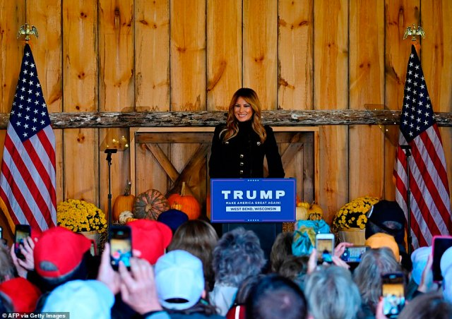 Fans snapped photos on their smartphones as Melania took to the podium to deliver her speech