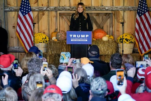 Melania Trump has implored Americans to 'practice safe, responsible behaviors' during the upcoming holiday season as she barnstormed the Midwest for her husband's reelection campaign on Saturday
