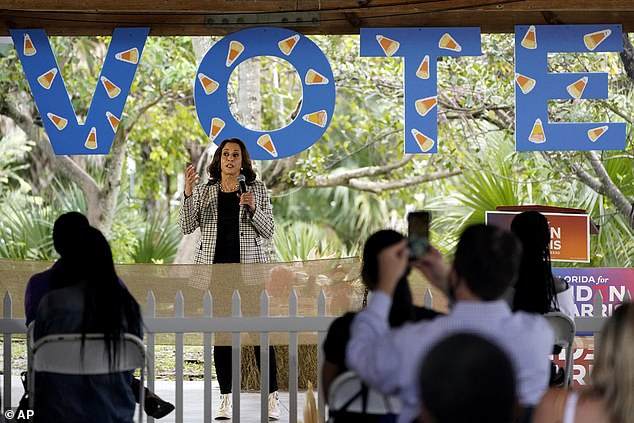 HAPPY HALLOWEEN: Harris gave a second speech in Florida Saturday in Ft. Lauderdale, with a large VOTE sign hanging behind her decorated with candy corn