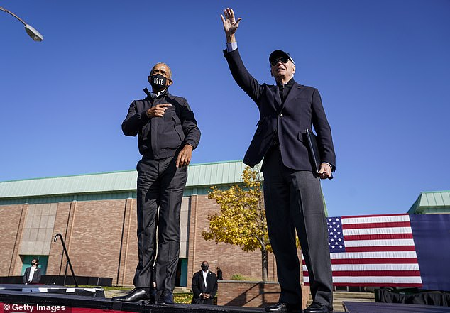 Biden and Obama held a pair of drive-in rallies Saturday in Flint and Detroit
