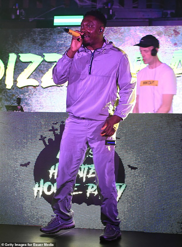 Rap star: Dizzee looked cool in his grey outfit as he took to the stage