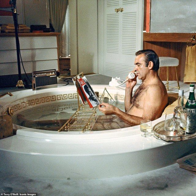 Scottish actor Sean Connery as James Bond taking a bath during the filming of 'Diamonds Are Forever', 1971