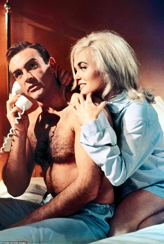 Sean Connery as 007 and actress Shriley Eaton on the set of the 1964 James Bond film, Goldfinger
