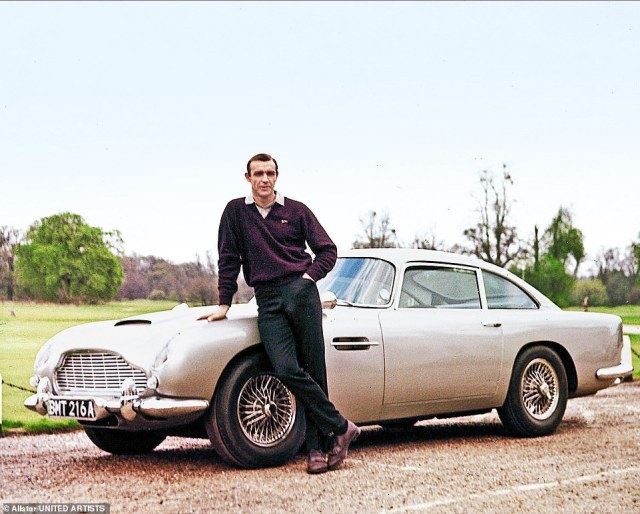 Sean Connery as Bond in 1964 with his Aston Martin DB5, now inextricably linked with the 007 films