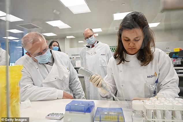 Prime Minister Scott Morrison takes a tour at the AstraZeneca in Sydney in August.Australia could have access to the COVID-19 vaccine in a matter of weeks