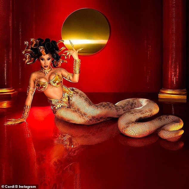 Stay gold: The 28-year-old channeled the late Aaliyah in Queen of the Damned, rocking a metallic gold-plated bra by Laurel DeWitt, with a scale-clad six-foot tail, created for her gorgeous signature curves by Baba Jagne