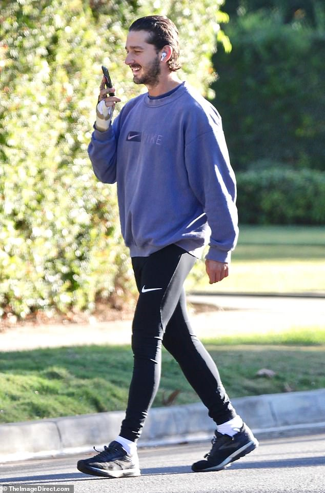 Glowing: The California Native lit up with a big beaming smile when he stopped to take a phone call during his jog