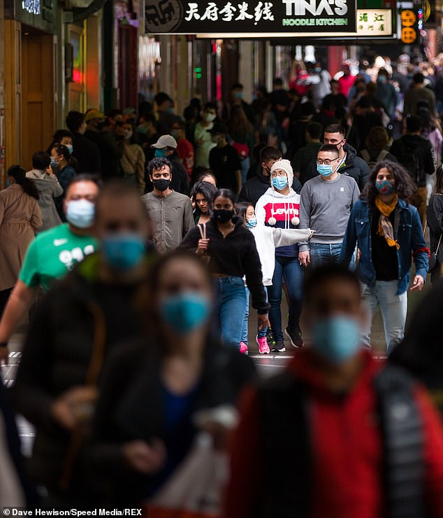 Mr Sutton noted regional Victoria had gone without any new cases of COVID-19 for a few weeks though mask wearing was still in place over transmission concerns (pictured, residents pack onto a Melbourne street over the weekend)