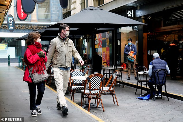 Mr Sutton would not elaborate how many days the state would need to go without any cases of COVID-19 before face masks were no longer necessary (pictured, Melbourne residents take a walk over the weekend)
