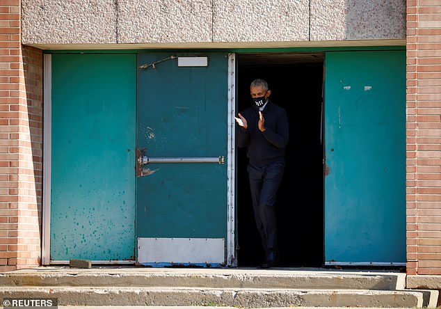 On his way: Barack Obama went to a high school in Flint for his appearance with Biden. Flint's African-American Democratic voters did not turn out in enough numbers for Hillary Clinton to bear Donald Trump in 2016