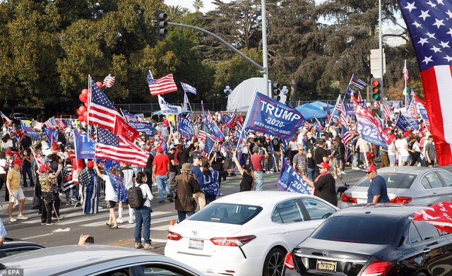 Supporters of US President Donald Trump fill the street during a rally in Beverly Hills, California on Saturday