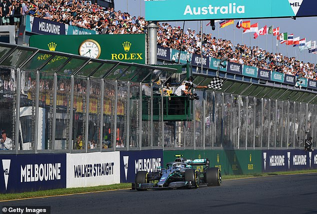 Victorian sport event organisers are preparing for large crowds after lockdown. Australian Grand Prix CEO Andrew Westacott hopes 60,000 fans will go in 2021. Pictured: Valtteri Bottas takes the chequered flag during the F1 Grand Prix of Australia in Melbourne in March 2019