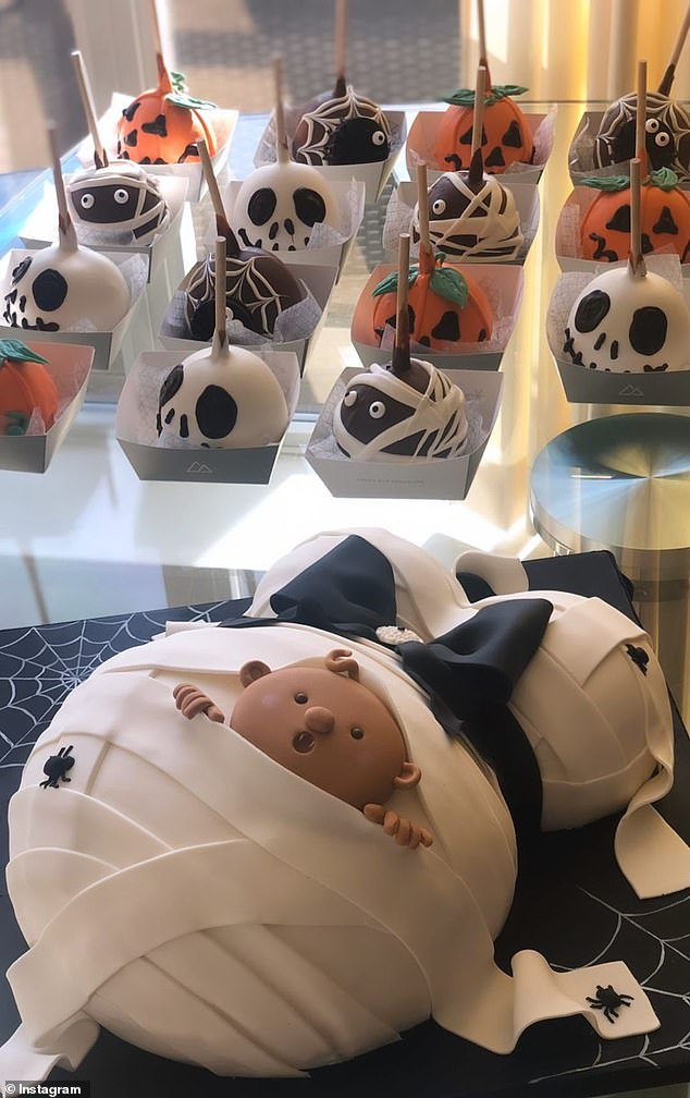 Mummy-to-be: There was also a cake shaped like a mummified pair of boobs and pregnant belly, with a cute baby vampire peeking out of the wraps
