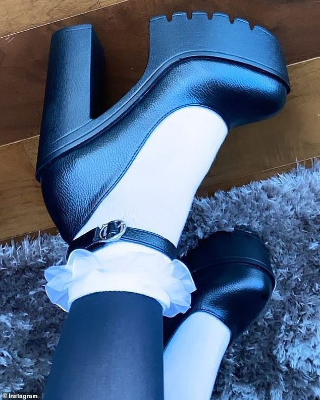 Guess who: She teased the costume earlier in the evening, posting a shot to her Insta Story of her black shoes, matching tights and white ruffled ankle socks
