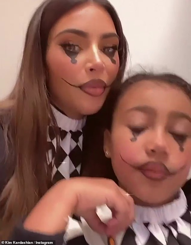 In character:As seen on her Insta Stories both Kim and North were all dressed up as clowns complete with black and white face makeup