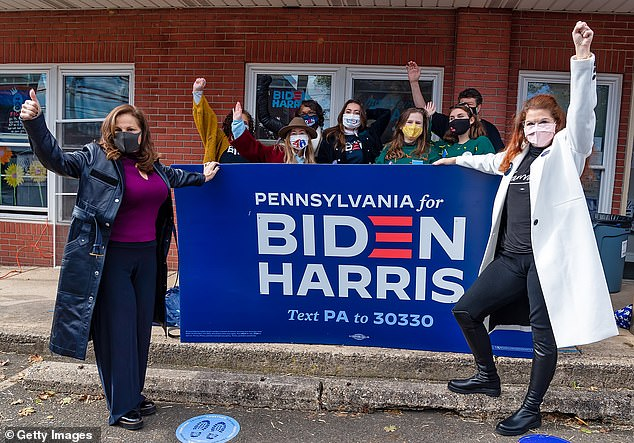 Democratic blue: The ladies met up with fellow volunteers and supporters at a Voter Activation Center in Jenkintown, just north of Philadelphia